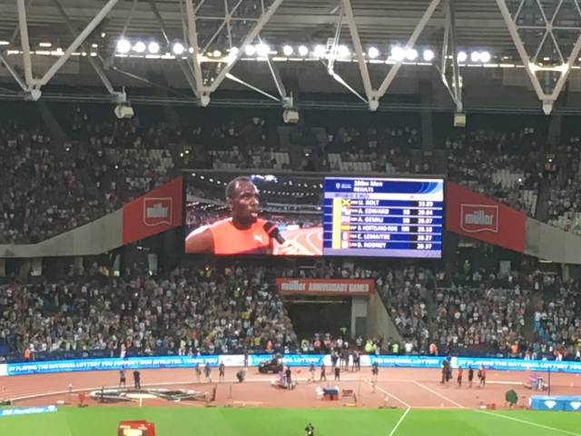 Usain Bolt interviewed on the giant video screen after winning the 200m.