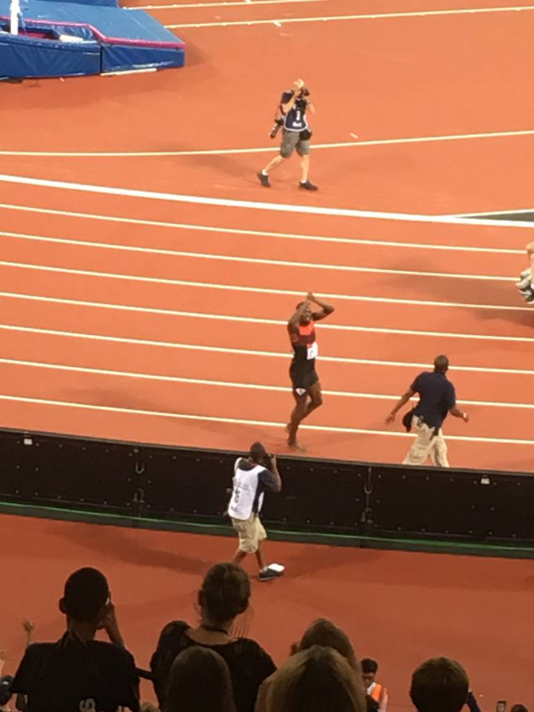 Usain Bolt goes on a lap of honour.